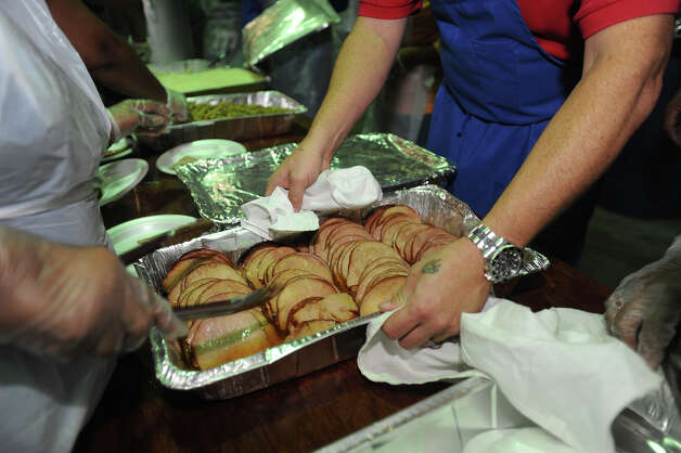 Sponsored by H-E-B, the Feast of Sharing event catered a free Christmas meal to thousands of people at Ford Park on Friday. Photo taken Friday, December 07, 2012 Guiseppe Barranco/The Enterprise Photo: Guiseppe Barranco, STAFF PHOTOGRAPHER / The Beaumont Enterprise