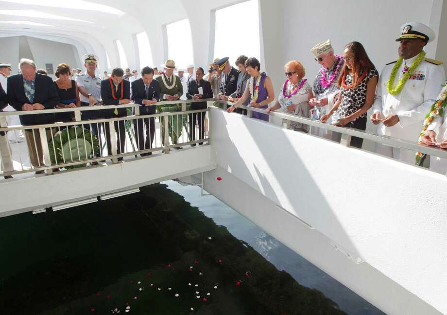 Flower petals are tossed into the water at the USS Arizona Memorial Friday, Dec. 7, 2012, at Pearl Harbor, Hawaii. Pearl Harbor Veterans and their family members from all over the United States gathered at the World War II Valor In The Pacific National Monument remembering the 71th anniversary of the Dec. 7, 1941 Japanese surprise attack on Pearl Harbor in Honolulu. Photo: Eugene Tanner, Associated Press / FR168001 AP