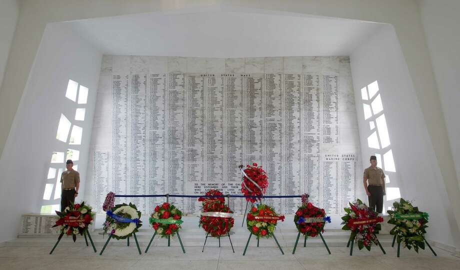 Wreaths from the various branches of the military and State of Hawaii are presented in shrine room of the USS Arizona Memorial Friday, Dec. 7, 2012, at Pearl Harbor, Hawaii. Pearl Harbor Veterans from all over the country gathered at the World War II Valor In The Pacific National Monument remembering the 71th anniversary of the Dec. 7, 1941 Japanese surprise attack on Pearl Harbor in Honolulu. Photo: Eugene Tanner, Associated Press / FR168001 AP