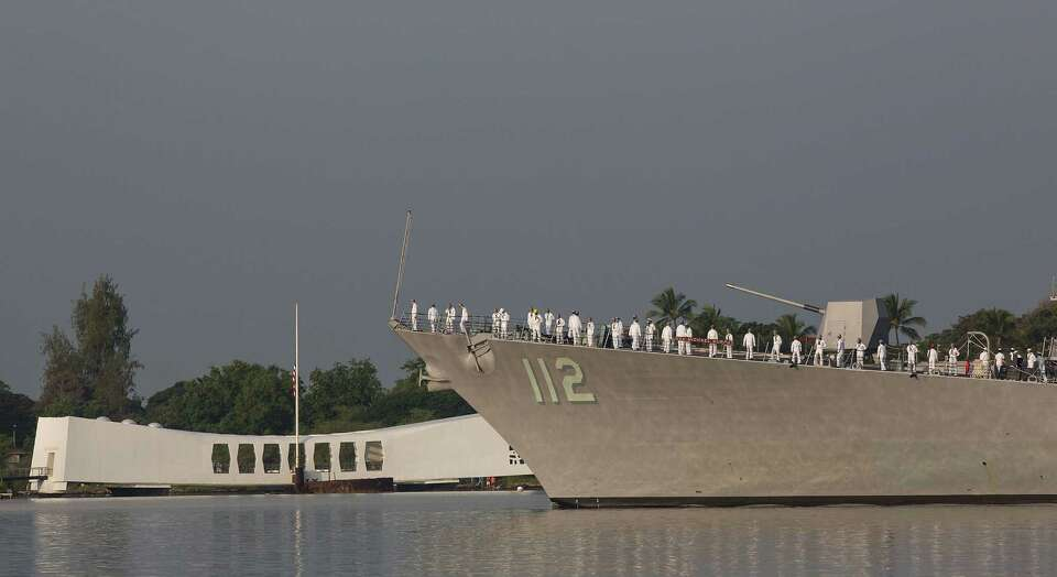 The USS Michael Murphy performs a pass in review near the USS Arizona Memorial during the 71st Annua