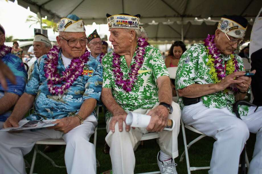 Pearl Harbor survivors Michael Ganitch of California and Robert McCoy of Hawaii talk during the 71st Annual Memorial Ceremony commemorating the WWII Attack On Pearl Harbor at the World War 2 Valor in the Pacific National Monument December 7, 2012 in Pearl Harbor, Hawaii. This is the 71st anniversary of the Japanese attack on pearl Harbor. Photo: Kent Nishimura, Getty Images / 2012  Getty Images