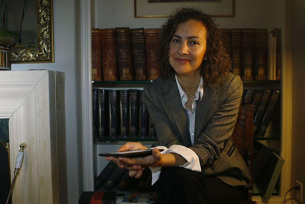 Sarah Ogilvie at home in San Francisco, Calif., showing her Oxford dictionaries on Wednesday, November 28, 2012.