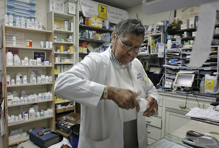 Pam Gumbs works at United Pharmacy in Berkeley, which provides a bin for disposal of unwanted or expired medicine. Photo: Michael Macor, The Chronicle