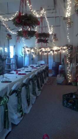 The DellaSortes converted their garage into a festive dining area where theyíll host a meal for over 30 family members this Christmas. Soft lighting adds a nice touch. Photo: Contributed Photo