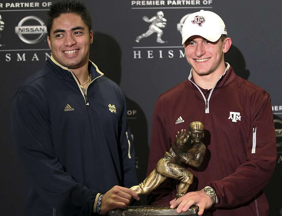 Notre Dame's Manti Te'o (left) and Texas A&M's Johnny Manziel with the Heisman Trophy. The winner of college football's biggest award will be announced Saturday. Photo: Mary Altaffer, Associated Press