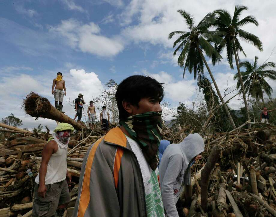 Relatives continue to search for their missing kin following a flash flood brought by Tuesday's Typhoon Bopha at New Bataan township, Compostela Valley in southern Philippines Friday Dec. 7, 2012. Rescuers were digging through mud and debris Friday to retrieve more bodies strewn across a farming valley in the southern Philippines by a powerful typhoon. Photo: Bullit Marquez, Associated Press / AP