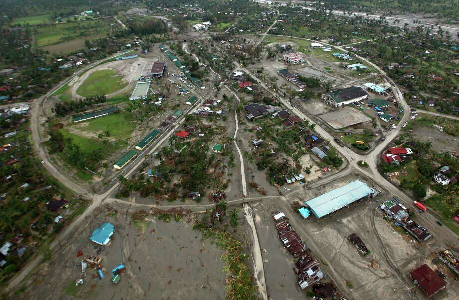 This handout photograph taken on December 7, 2012 and released by Malacañang Photo Bureau (MPB) shows an aerial view of a decimated small town in Compostela Valley in the southern Philippines in the aftermath of Typhoon Bopha. Hundreds of thousands of survivors of a deadly typhoon crammed into packed shelters on December 7, braving the stench of corpses as the government vowed action to prevent storm disasters. Typhoon Bopha whipped the south on December 4, leaving at least 546 people dead and hundreds more missing in the deadliest natural disaster this year in a country that is regularly hit with quakes, floods and volcanic eruptions. Photo: JAY MORALES, AFP/Getty Images / AFP
