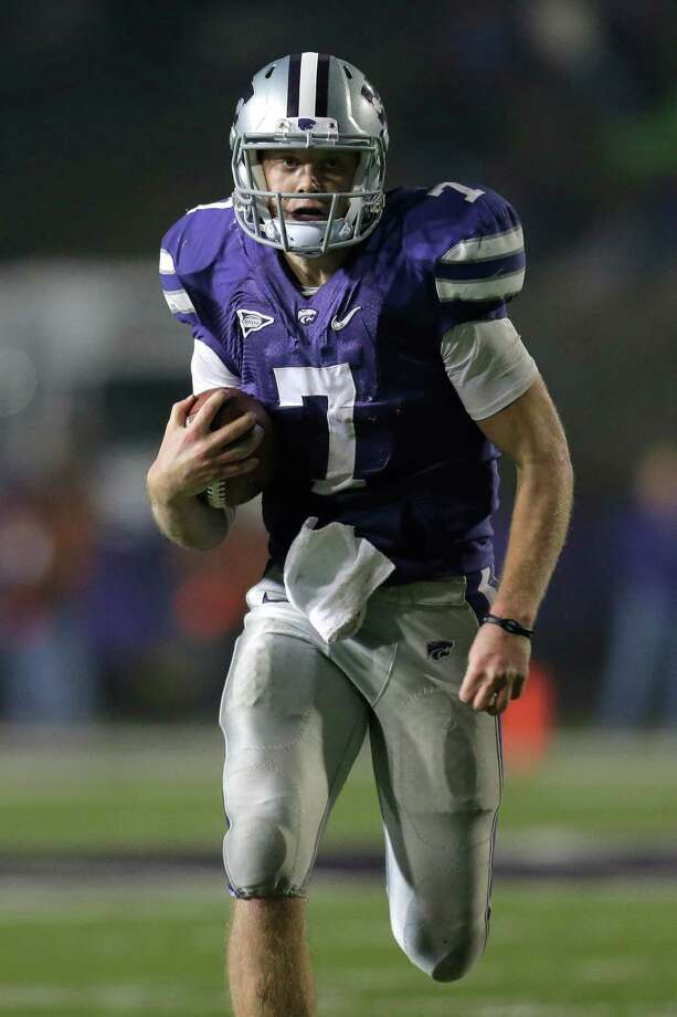 Kansas State quarterback Collin Klein has rushed for a touchdown in 11 consecutive games. Photo: Charlie Riedel, STF / AP