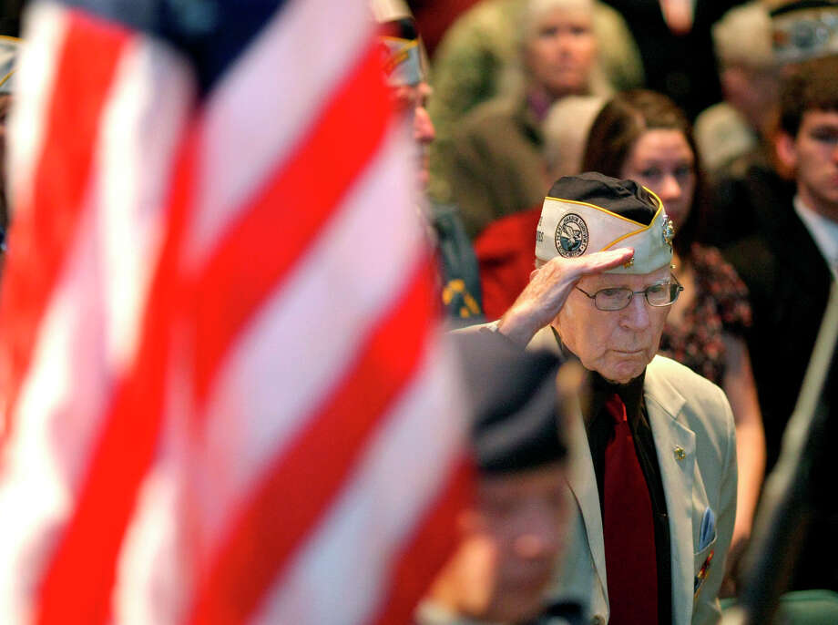 "Pearl Harbor survivor Maynard "" Rocky"" Hoffmann, of Bremerton, Wash., salutes during the parade of colors at the Pearl Harbor Remembrance, Friday, Dec. 7, 2012, at Naval Undersea Museum in Keyport, Wash.  Hoffmann was stationed at Ewa Marine Corps Air Station. Photo: Larry Steagall, Associated Press / Kitsap Sun"