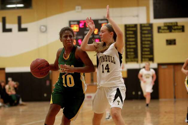 Mike Ross Connecticut Post freelance -Trinity Catholic's # 10  Nat Senoble drives past Trumbull High School defender #14 Danielle McGillicuddy during first half action on Friday evening. Photo: Mike Ross / Connecticut Post Freelance