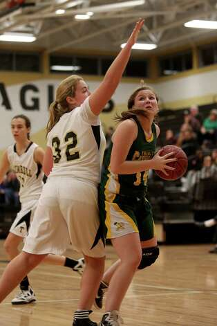 Mike Ross Connecticut Post freelance -Trinity Catholic's # 14 Katelyn Spielman's eyes the basketball against Trumbull High School defender # 32 Erin Moore during first half action on Friday evening. Photo: Mike Ross / Connecticut Post Freelance