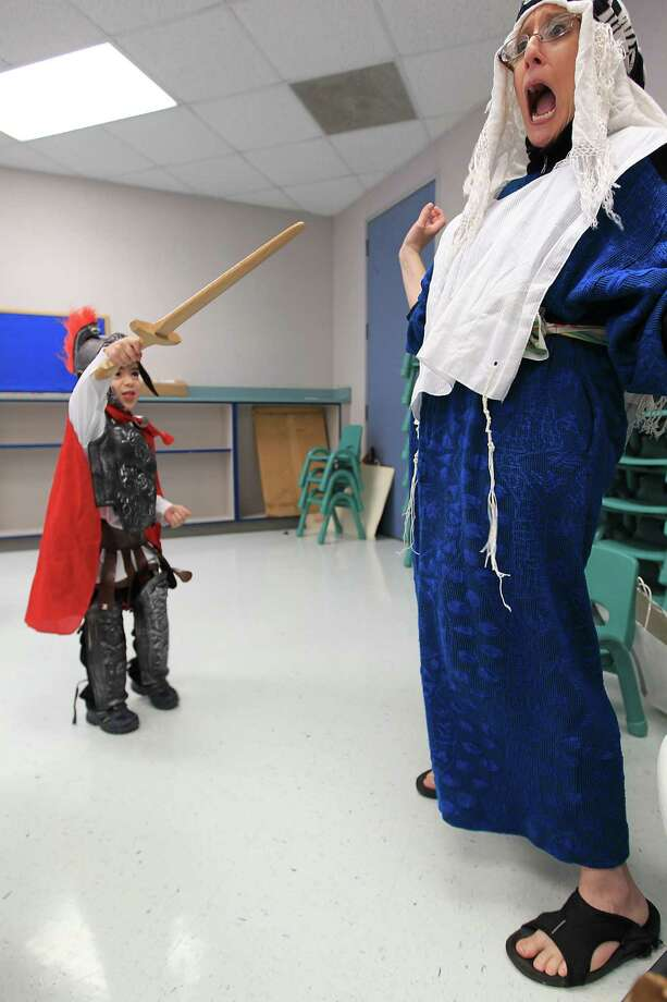 A pre-school student, dressed as a Syrian Army soldier, pretends to stab Alana Shepetofsky, Judaic Curriculum Specialist, as they celebrate Hanukah, the Festival of Lights, at Bertha Alyce Early Childhood Center at the Evelyn Rubenstein Jewish Community Center of Houston. Photo: Karen Warren, Houston Chronicle / © 2012  Houston Chronicle