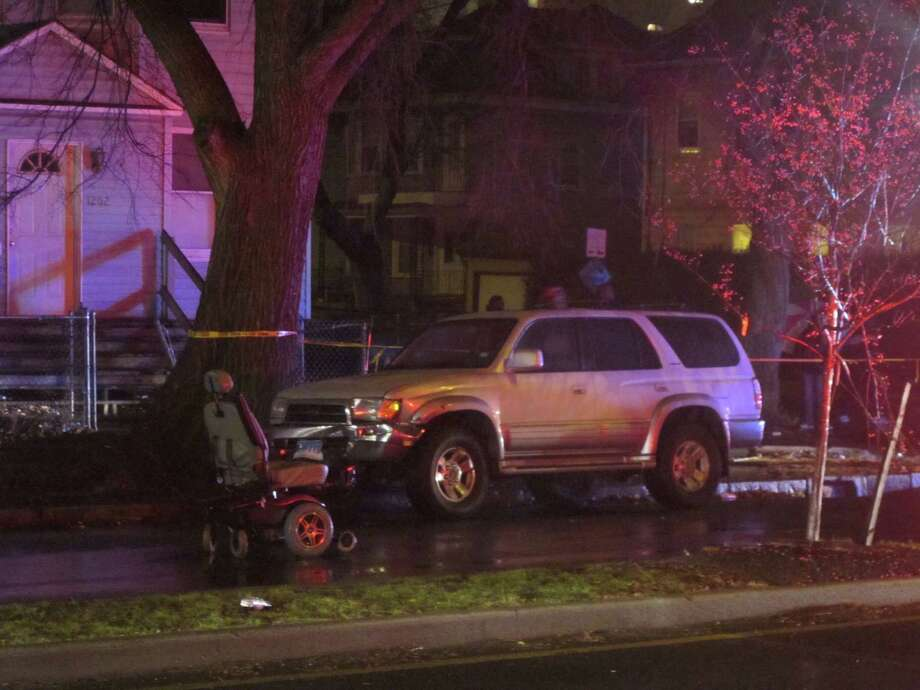 A man in an electric wheelchair was hospitalized with serious injuries after he was hit by a sports-utility vehicle on Park Avenue in Bridgeport, Conn. on Friday, Dec. 7, 2012. Photo: Tom Cleary