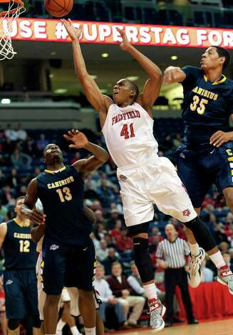 Fairfield University's Keith Matthews goes up for a shot in a men's basketball game against Canisius College played at Webster Bank Arena, Bridgeport CT on Friday December 7th, 2012. Photo: Mark Conrad / Connecticut Post Freelance