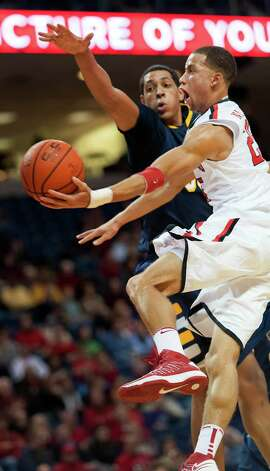 Fairfield University's Colin Nickerson drives to the basket to take a shot in a men's basketball game against Canisius College played at Webster Bank Arena, Bridgeport CT on Friday December 7th, 2012. Photo: Mark Conrad / Connecticut Post Freelance