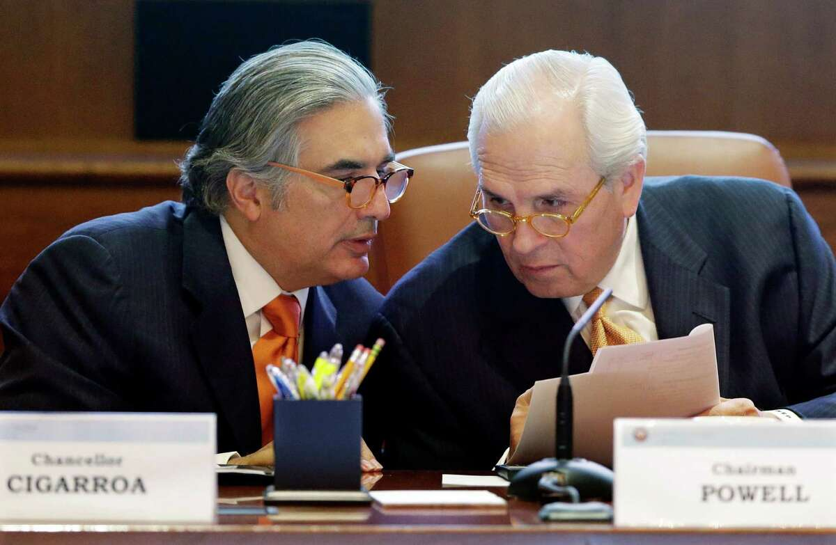 University of Texas Systems Chancellor Francisco Cigarroa, left, and chairman Gene Powell, right, talk during a meeting, Thursday, Dec. 6, 2012, in Austin, Texas. Regents approved creating a new university in the Rio Grande Valley with a medical school. The plan announced Thursday calls for combining the UT Pan-American and the UT Brownsville campuses and would inject $100 million into establishing a new medical school.(AP Photo/Eric Gay)