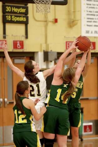 Mike Ross Connecticut Post freelance -Trumbull High School's #21 Kristina Vetter fights for a rebound against Trinity Catholic's #14 Katelyn Spielman and # 5 Kellie Hurd during first half action on Friday evening. Photo: Mike Ross / Connecticut Post Freelance