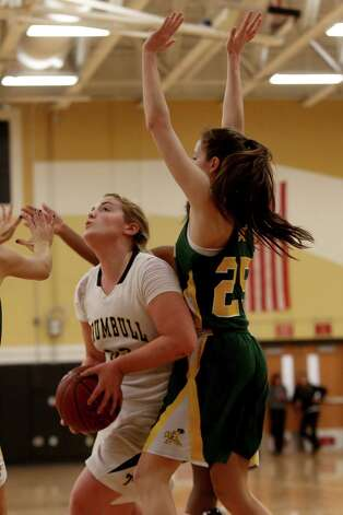 Mike Ross Connecticut Post freelance -Trumbull High School's captain #32 Erin Moore works her way to the basket as Trinity Catholic's #25 Allison Palma defends during first half action on Friday evening. Photo: Mike Ross / Connecticut Post Freelance