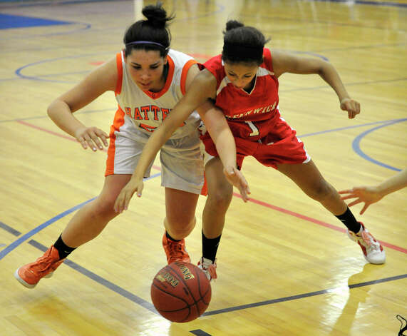 Danbury's Kayla Handberry battles Greenwich's Jenny Cespedes for the loose ball during their game at Danbury High School on Friday, Dec. 7, 2012. Danbury won, 54-34. Photo: Jason Rearick / The News-Times