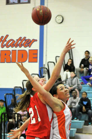 Greenwich's Abbie Wolf battles Danbury's Kayla Handberry for the rebound during their game at Danbury High School on Friday, Dec. 7, 2012. Danbury won, 54-34. Photo: Jason Rearick / The News-Times