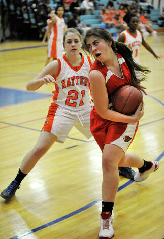 Greenwich's Rebecca Kural keeps the ball from Danbury's Kaitlin Aldridge during their game at Danbury High School on Friday, Dec. 7, 2012. Danbury won, 54-34. Photo: Jason Rearick / The News-Times