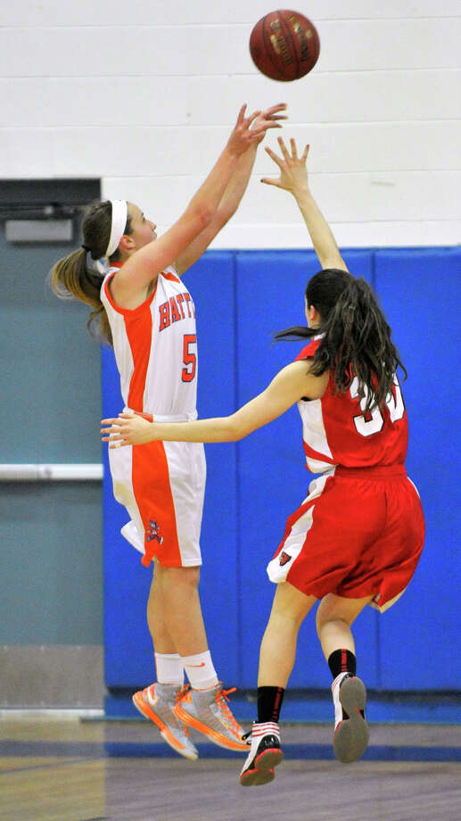 Danbury's Rachel Gartner shoots over Greenwich's Leigh Galletta during their game at Danbury High School on Friday, Dec. 7, 2012. Danbury won, 54-34. Photo: Jason Rearick / The News-Times