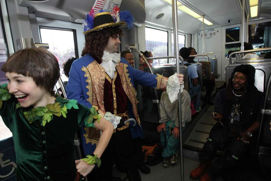 Peter Pan and Captain Hook visit with rail commuters during a promotional ride for the up coming Peter Pan play on the METRORail. Photo: Nick De La Torre, Houston Chronicle / © 2012  Houston Chronicle