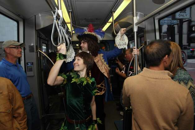 Peter Pan and Captain Hook visit with rail commuters during a promotional ride for the up coming Peter Pan play. Photo: Nick De La Torre, Houston Chronicle / © 2012  Houston Chronicle