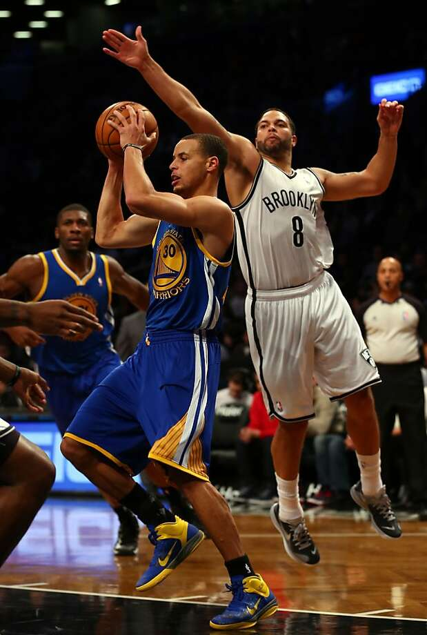 NEW YORK, NY - DECEMBER 07:  Stephen Curry #30 of the Golden State Warriors tries to pass as Deron Williams #8 of the Brooklyn Nets defends on December 7, 2012 at the Barclays Center in the Brooklyn borough of New York City.  NOTE TO USER: User expressly acknowledges and agrees that, by downloading and/or using this photograph, user is consenting to the terms and conditions of the Getty Images License Agreement.  (Photo by Elsa/Getty Images) Photo: Elsa, Getty Images