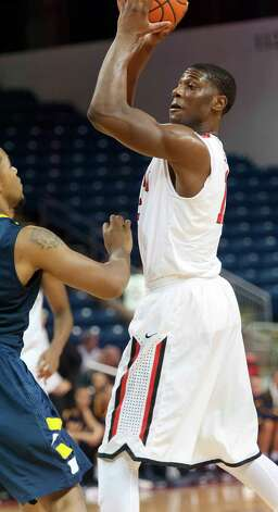 Fairfield University's Maurice Barrow looks to pass off the ball in a men's basketball game against  Canisius College played at Webster Bank Arena, Bridgeport CT on Friday December 7th, 2012. Photo: Mark Conrad / Connecticut Post Freelance