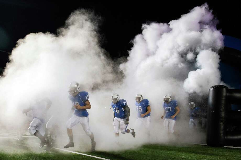 Navasota players take the field before a Class 3A Division II Region III high school football playoff game against West Orange-Stark. Photo: Smiley N. Pool, Houston Chronicle / © 2012  Houston Chronicle