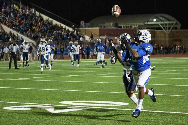 Navasota's Austin Collins (2) hauls in a 46-yard touchdown pass as West Orange-Stark's Quentin Tezeno (29) defends. Photo: Smiley N. Pool, Houston Chronicle / © 2012  Houston Chronicle