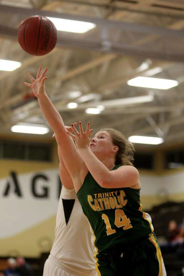 Mike Ross Connecticut Post freelance -Trinity Catholic's # 14 Katelyn Spielman's scores against Trumbull High School defender during first half action on Friday evening. Photo: Mike Ross / Connecticut Post Freelance