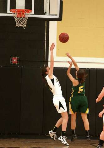 Mike Ross Connecticut Post freelance -Trinity Catholic's # 5 Kellie Hurd goes to the basketball and scores and picks up a foul against Trumbull High School defender #11 Rachel Carron during first half action on Friday evening. Photo: Mike Ross / Connecticut Post Freelance