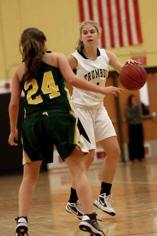 Mike Ross Connecticut Post freelance -Trumbull High School's #1 Alexa Pfohl looks for an open teammate against Trinity Catholic's #24 Siobhan Kirby during first half action on Friday evening. Photo: Mike Ross / Connecticut Post Freelance