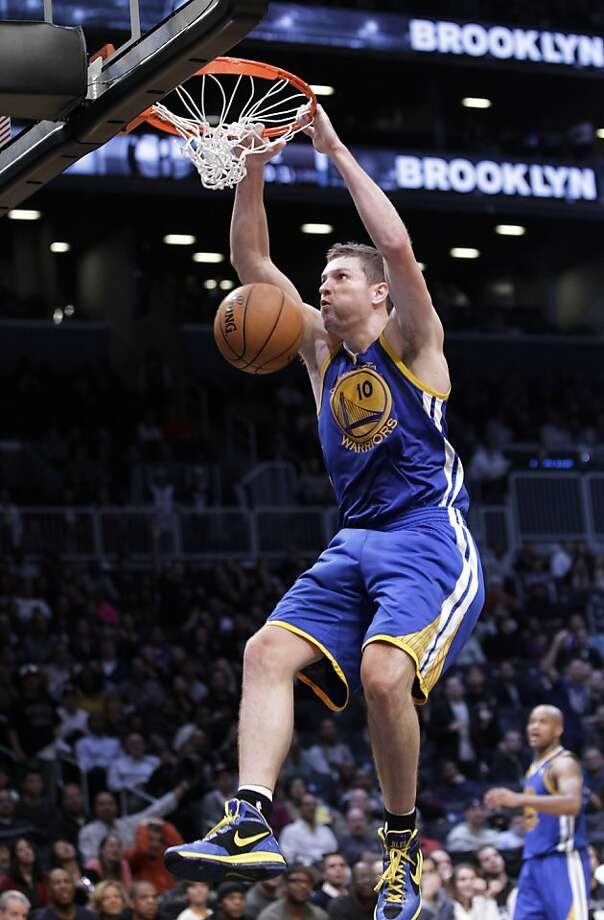 Golden State Warriors forward David Lee (10) dunks the ball during the second half of their 109-102 win over the Brooklyn Nets in an NBA basketball game at the Barclays Center, Friday, Dec. 7, 2012, in New York. (AP Photo/Kathy Willens) Photo: Kathy Willens, Associated Press