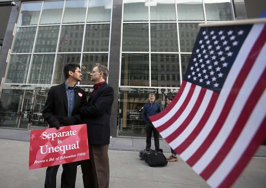 In this file photo from Jan. 11, 2010, Stuart Gaffney, left, and John Lewis, same-sex partners for 22 years, huddle outside of the federal courthouse in San Francisco. The U.S. Supreme Court decided Friday, Dec. 7, 2012, to hear the appeal of a ruling that struck down Proposition 8, the state's measure that banned same sex marriages. The highly anticipated decision by the court means same-sex marriages will not resume in California any time soon. The justices likely will not issue a ruling until spring of next year. A federal appeals court ruled in February that Proposition 8's ban on same-sex marriage was unconstitutional. But the court delayed implementing the order until same-sex marriage opponents proponents could ask the U.S. Supreme Court to review the ruling. (AP Photo/Marcio Jose Sanchez) Photo: Marcio Jose Sanchez, Associated Press