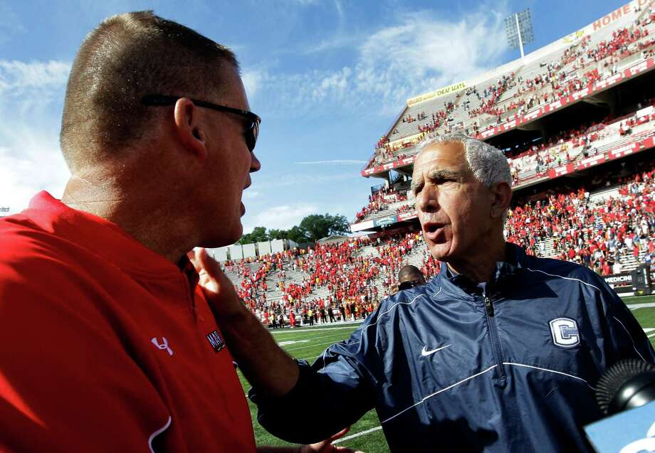 Maryland head coach Randy Edsall, left, speaks with Connecticut head coach Paul Pasqualoni after an NCAA college football game in College Park, Md., Saturday, Sept. 15, 2012. Connecticut won 24-21. (AP Photo/Patrick Semansky) Photo: Patrick Semansky, Associated Press / AP