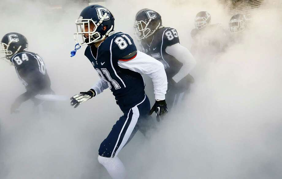 EAST HARTFORD, CT - DECEMBER 1: Michael Matson #81 of the Connecticut Huskies runs onto the field with his teammates prior to the game against the Cincinnati Bearcats during the game at Rentschler Field on December 1, 2012 in East Hartford, Connecticut. (Photo by Jared Wickerham/Getty Images) Photo: Jared Wickerham, Getty Images / 2012 Getty Images