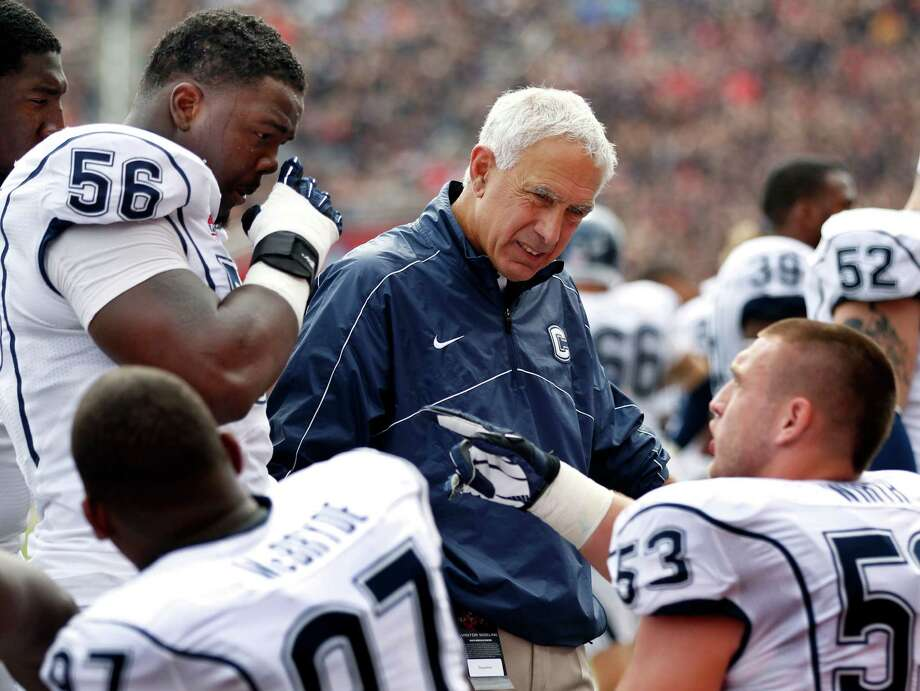 Connecticut head coach Paul Pasqualoni talks to his players during the first half of an NCAA college football game against Rutgers in Piscataway, N.J., Saturday, Oct. 6, 2012. (AP Photo/Mel Evans) Photo: Mel Evans, Associated Press / AP