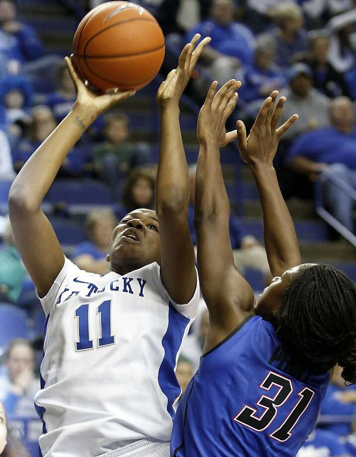 CORRECTS DATE - Kentucky's DeNesha Stallworth (11) shoots under pressure from DePaul's Jasmine Penny during the first half of an NCAA college basketball game at Rupp Arena in Lexington, Ky., Friday, Dec. 7, 2012. (AP Photo/James Crisp) Photo: James Crisp, Associated Press