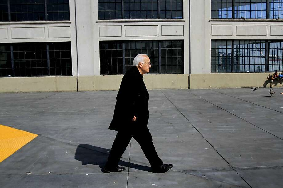 Alessandro Baccari Jr., who writes about the Italian American experience in North Beach, strolls on the wharf. Photo: Sarah Rice, Special To The Chronicle
