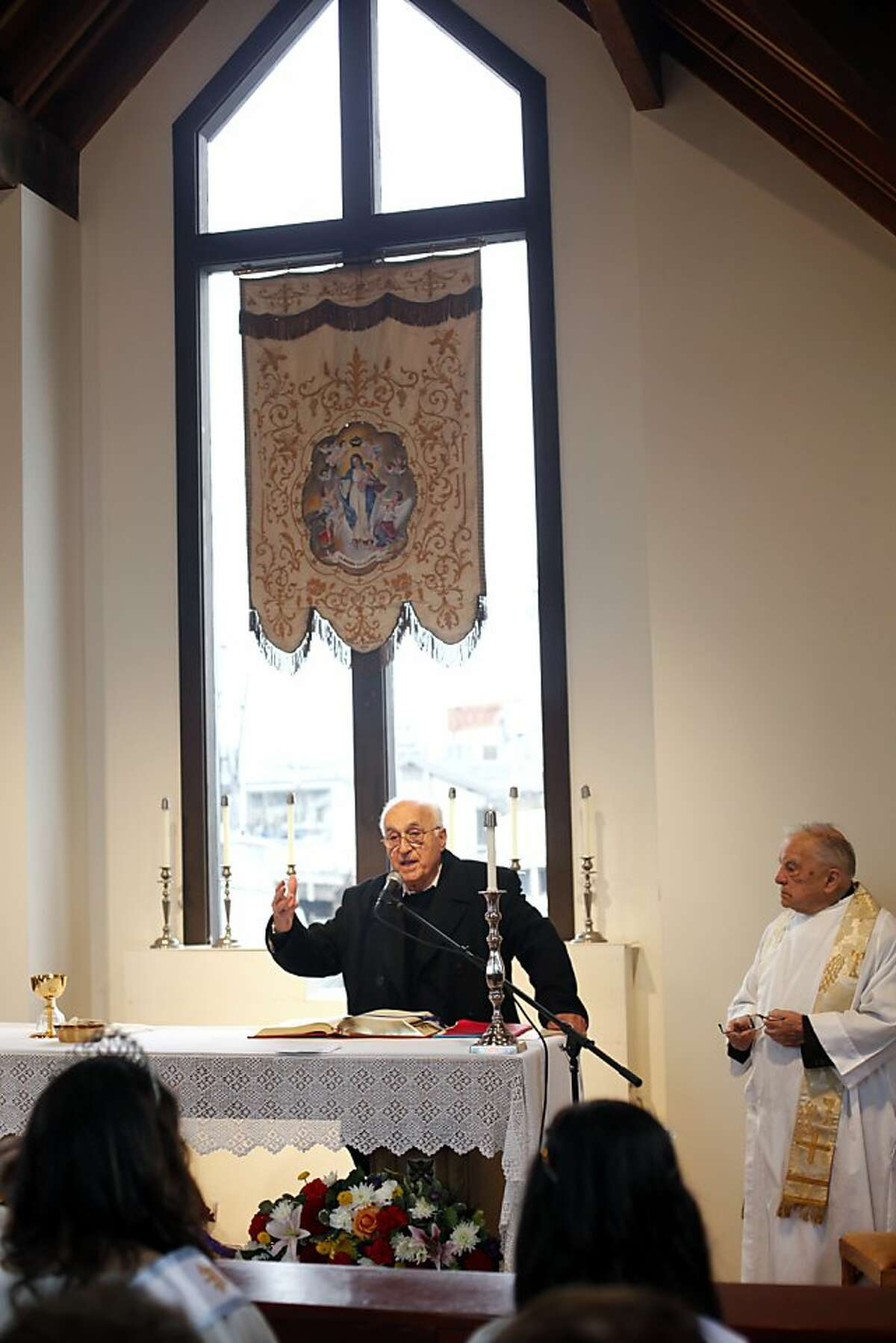 Alessandro Baccari Jr. speaks during Mass at the Fishermen's and Seamen's Memorial Chapel.