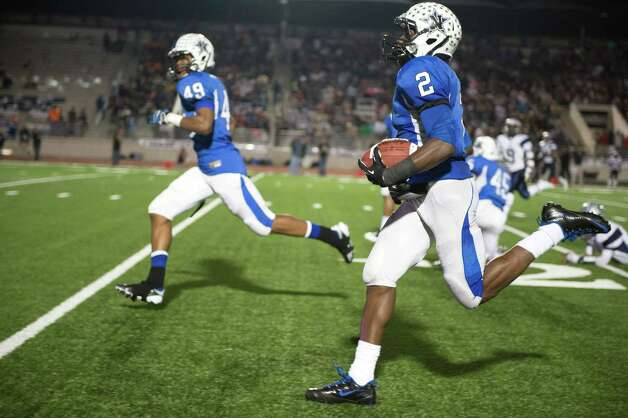 Navasota's Austin Collins (2) returns an interception for a touchdown. Photo: Smiley N. Pool, Houston Chronicle / © 2012  Houston Chronicle