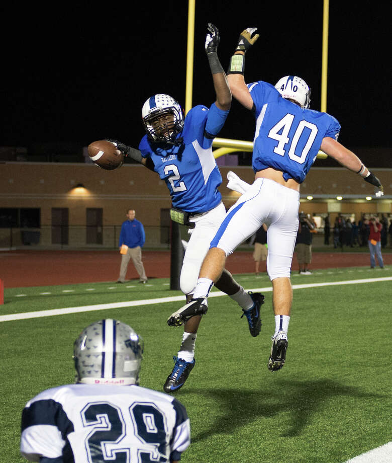 Navasota's Austin Collins celebrates with Hunter Sparkman after catching a 46-yard touchdown pass during the first quarter. Photo: Smiley N. Pool, Houston Chronicle / © 2012  Houston Chronicle