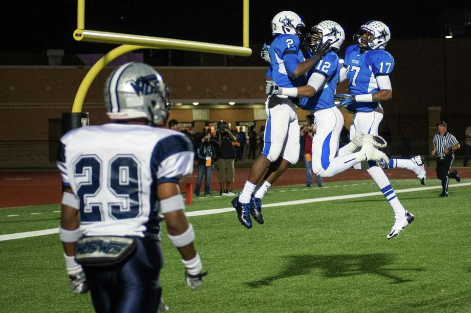 Navasota's Austin Collins (2) celebrates with Solomon McGinty (12) and Terrance Creeks (17) after scoring past West Orange-Stark's Quentin Tezeno (29) on 46-yard touchdown pass. Photo: Smiley N. Pool, Houston Chronicle / © 2012  Houston Chronicle
