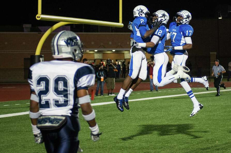 Navasota's Austin Collins (2) celebrates with Solomon McGinty (12) and Terrance Creeks (17) after sc
