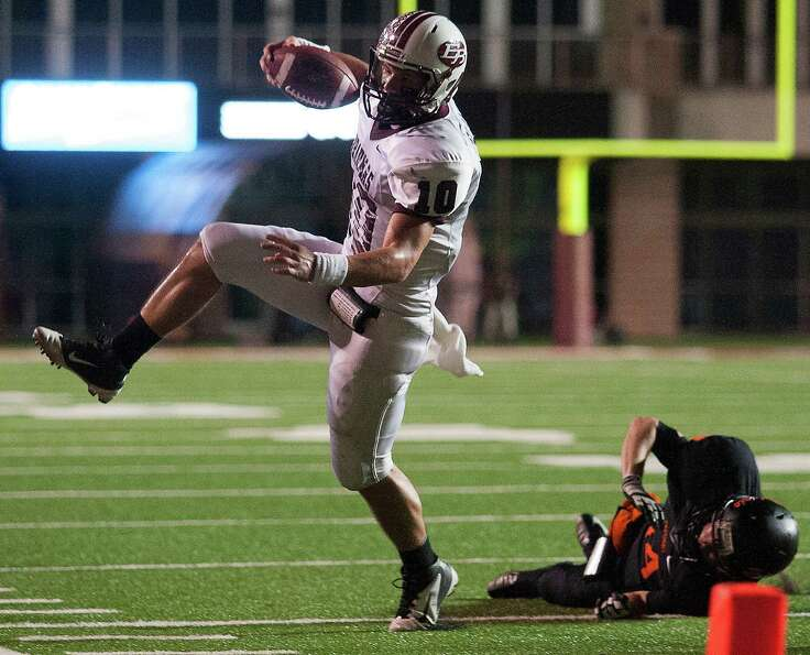 East Bernard wide receiver Ty Slanina (10) leaps past Refugio defensive back Cameron Sternadel (14).