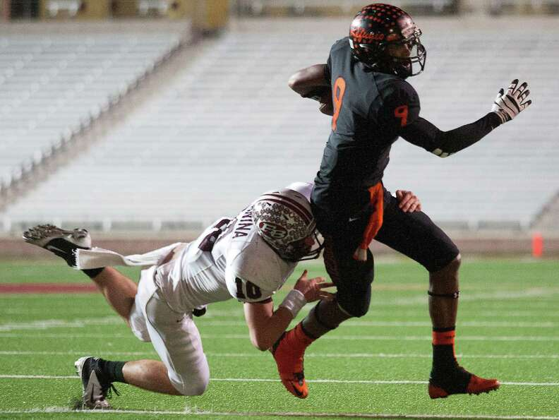 Refugio wide receiver Marcus Thompson (9) runs past East Bernard defensive back Ty Slanina (10).