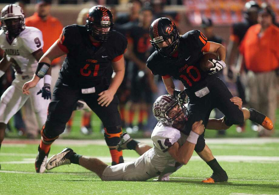 Refugio wide receiver Tyler Castellano (10) is brought down by East Bernard defensive back Grant Aschenbeck (14). Photo: J. Patric Schneider, For The Chronicle / © 2012 Houston Chronicle